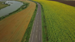 Aerial View. Cars on a winding road in the hills at countryside Stock Footage