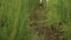 Beautiful couple in love in traditional ukrainian clothes  walking barefoot and Stock Footage