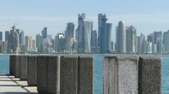 Doha Qatar skyline seen from the corniche promenade Stock Footage