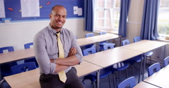 4k,Portrait of a happy and proud African American school teacher in a classroom. Stock Footage