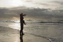 Father and daughter by the sea Stock Photos