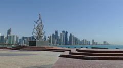 The Corniche with a statue and the Doha skyline - stock footage