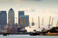 Canary wharf and millennium dome - stock photo