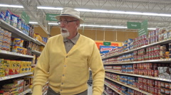 Lonely old man shopping for groceries Stock Footage
