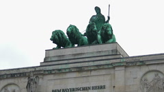 Bavaria statue with lions atop Siegestor triumphal arch, Munich top attraction Stock Footage