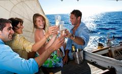 Two couples making a toast on sailboat Stock Photos
