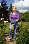 Portrait of female gardener with spade Stock Photos