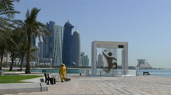 Man cleaning the Corniche Promenade - stock footage
