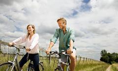 Couple on cycles Stock Photos