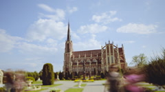 Beautiful European church in a sunny day. Timelapse. Tilt-shift Stock Footage