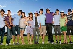 Teen group portrait standing in park Stock Photos