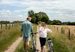 Couple walking with cycles - stock photo