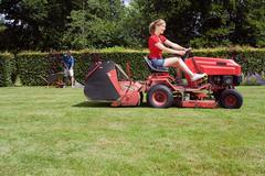 Women mowing lawn Stock Photos