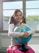 Girl with earth globe Stock Photos