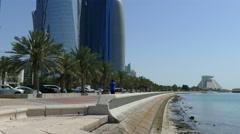 Man walks at the Corniche Promenade in Doha Stock Footage