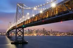 Dusk over Oakland-San Francisco Bay Bridge and San Francisco Skyline, California Kuvituskuvat