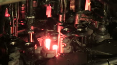 Molten glass. Glass recycling. Bottle manufacturing industrial factory Stock Footage