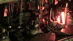 Molten glass. Glass recycling. Bottle manufacturing industrial factory - stock footage