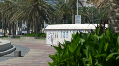 Arabic man walking at the Corniche Promenade Stock Footage