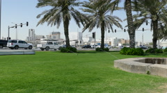 Watering the grass at the Corniche Promenade in Doha Stock Footage