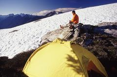 Climber and tent at north cascades national park - stock photo