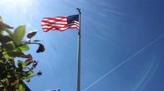 American Flag waving proud in the wind and sunshine jib shot 4k Stock Footage