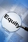 Word equity under magnifying glass - stock photo