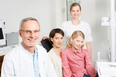 Dentist and patients Stock Photos