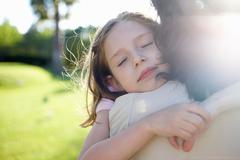 Mother and daughter embracing - stock photo