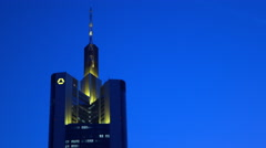 Commerzbank building in downtown Frankfurt at night 4k Stock Footage