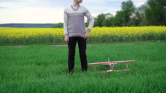 Kid plays with toy airplane in the field. 4k - stock footage