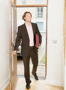 Business man arrives home Stock Photos