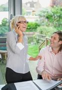 Couple conduct business over the phone Stock Photos