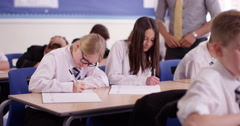 4k, A teacher helping his students with their work in the classroom. Stock Footage