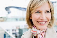 Woman close up smiling into distance Stock Photos