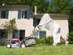 Bride mowing lawn Stock Photos