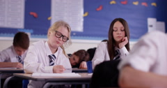 4k, A young student struggling during a test in a school. Stock Footage