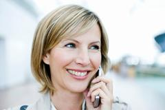 Woman smiling talking on cell phone Stock Photos