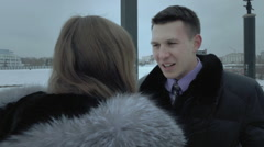 Man tries to justify his being late for date. Girl attacks him Stock Footage