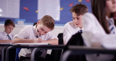 4k, Two secondary school students talking to each other in a class room - stock footage