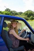 Young woman at wheel of electric car Stock Photos