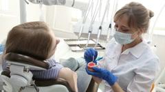 Dentist Demonstrating Model Teeth Stock Footage