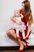 Beauty mother with toddler - stock photo