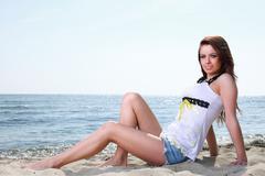 Beach holidays woman enjoying summer sun sand looking happy Stock Photos