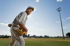 Baseball pitcher holding a baseball Stock Photos