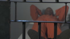 Modern Prison or Jail Scene - lying in bed - stock footage