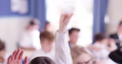 4k, Close-up shot of  school children in classroom raising arms. Stock Footage