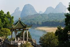 Temple and li river in yangshuo - stock photo