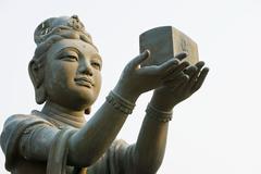 Statue near tian tan buddha - stock photo
