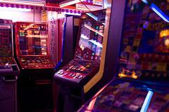 Slot machines in amusement arcade - stock photo